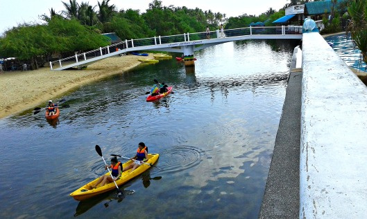 Tourists enjoying kayak on the river of Ilog-Malino.
