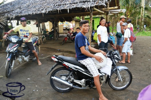 "After taking a boat, a group of ""habal-habal"" drivers are already waiting for a ride."
